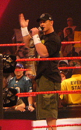 Cena addressing fans at a Raw show.