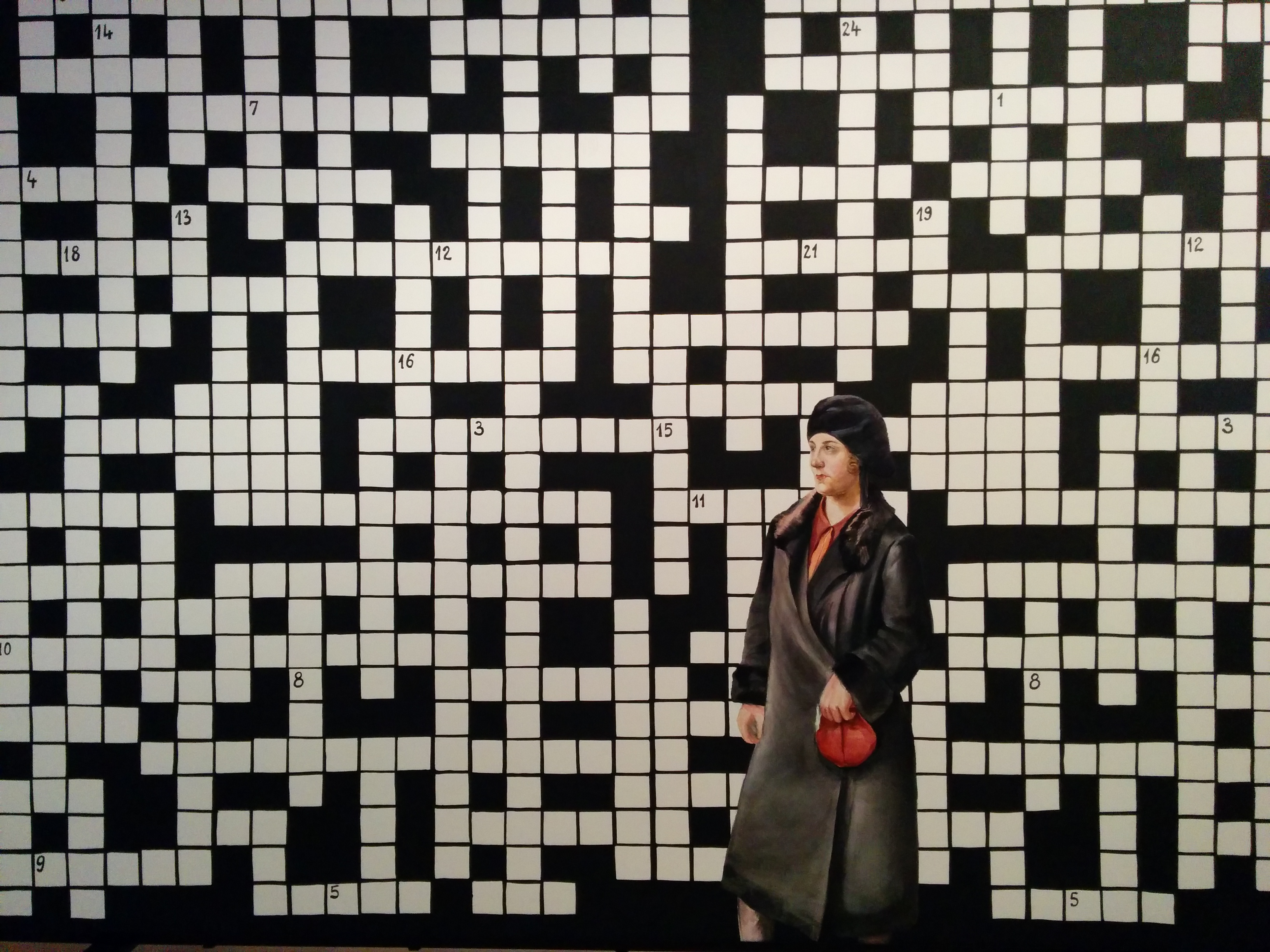 File:Crossword puzzle with lady in black coat.jpg - Wikimedia Commons