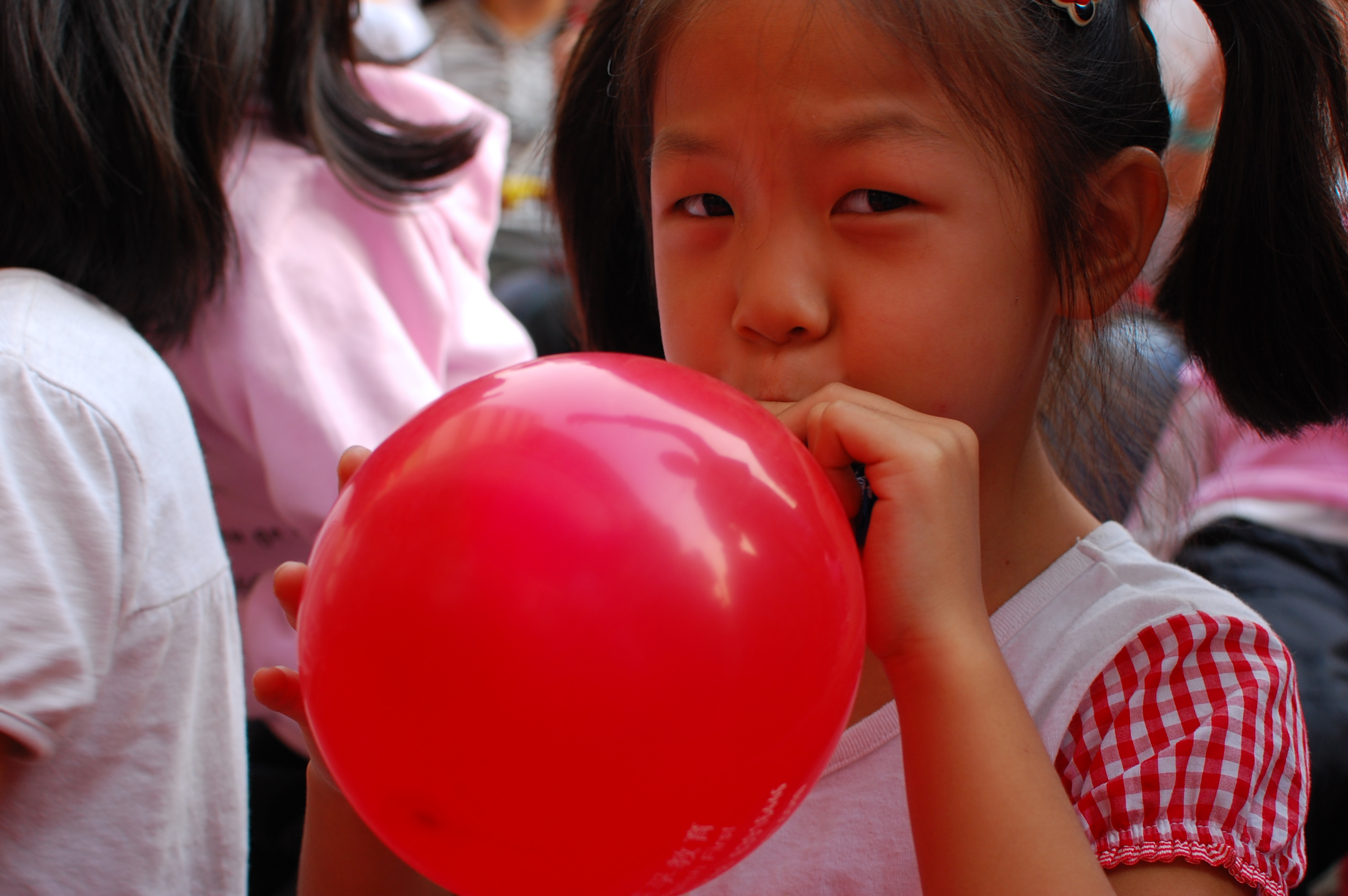 Image result for blowing balloon
