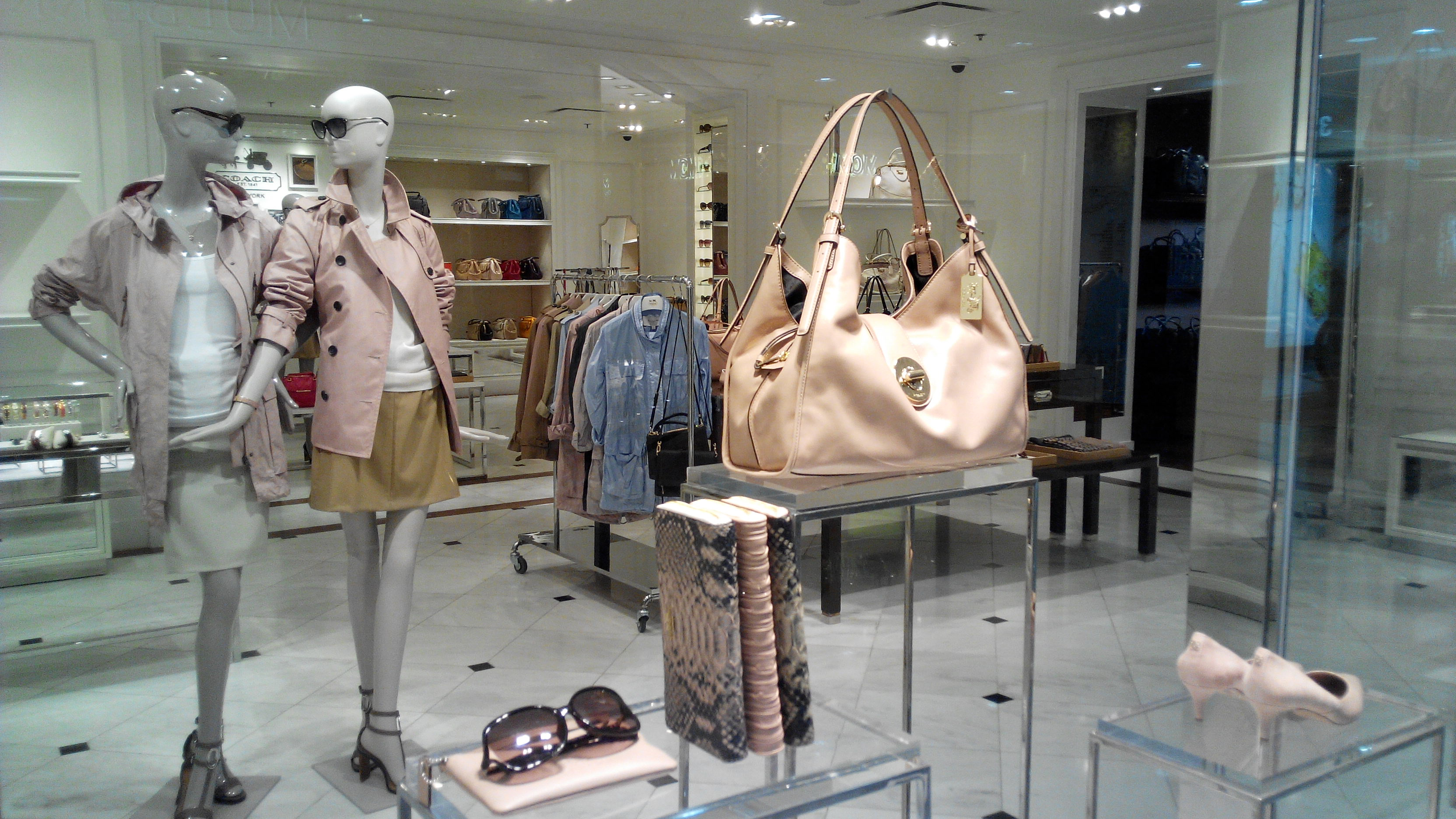 Image result for coach handbag in shop