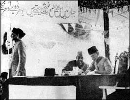 Chaudhari Khaliquzzaman (left) seconding the 1940 Lahore Resolution of the Muslim League with Jinnah (right) presiding, and Liaquat Ali Khan (centre)