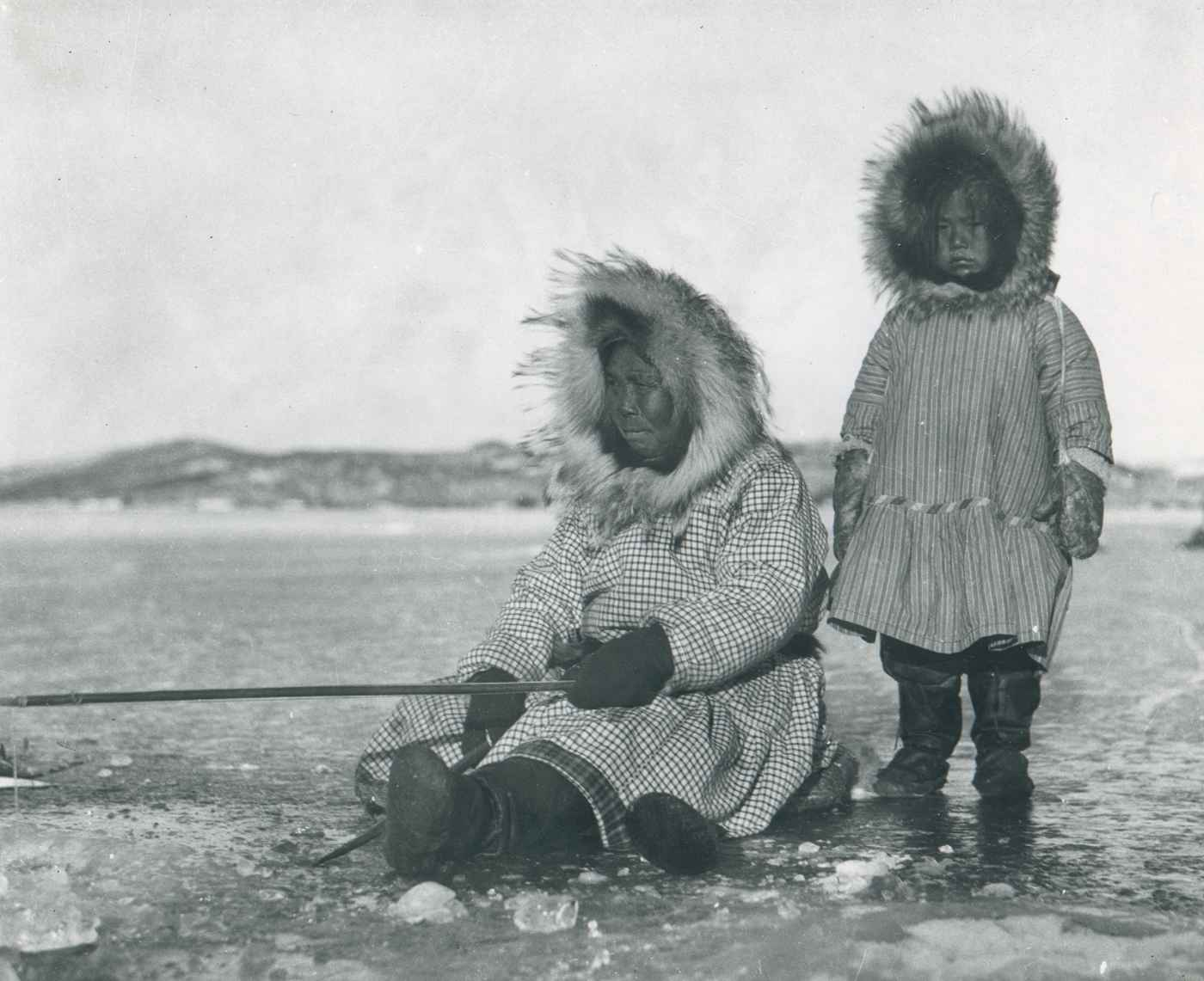 File:Eskimos woman and girl ice fishing.jpg