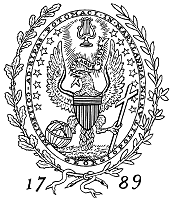 A vertical oval shaped black and white design with a bald eagle whose wings are spread and who is grasping a globe and a cross with its claws. Around the seal are leaves and the numbers 17 and 89 on either side.