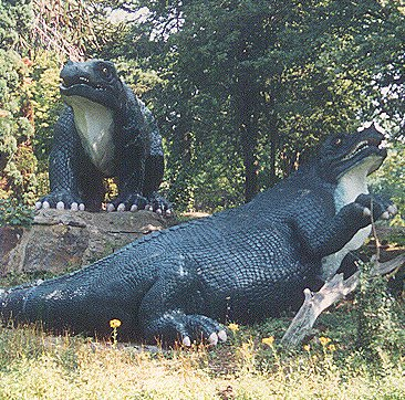 Iguanodon models in 1995, before restoration, showing previous countershaded paint scheme with white undersides Iguanodons crystal palace email.jpg