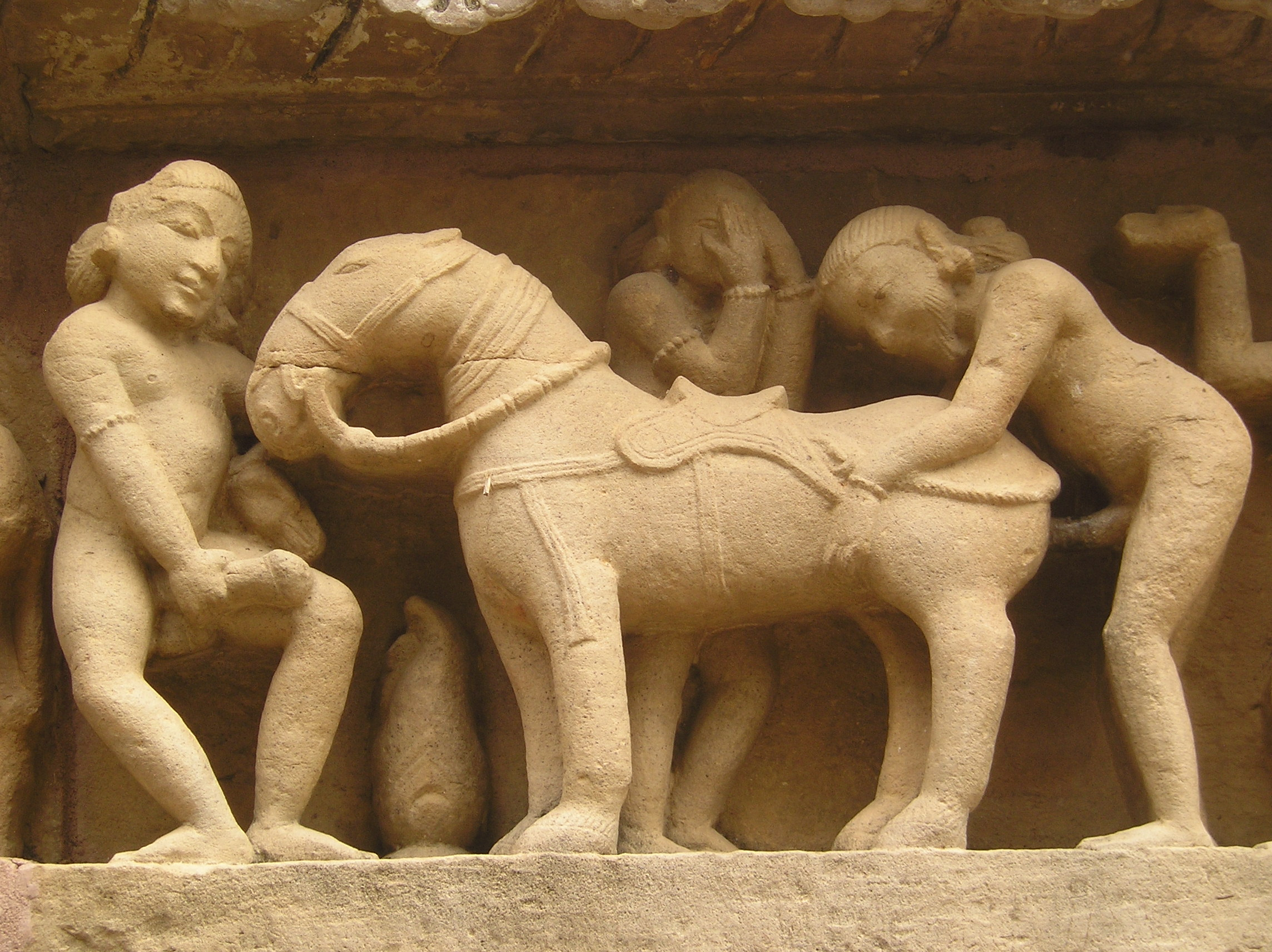 http://upload.wikimedia.org/wikipedia/commons/6/62/Khajuraho-Lakshmana_Temple_erotic_detal3.JPG