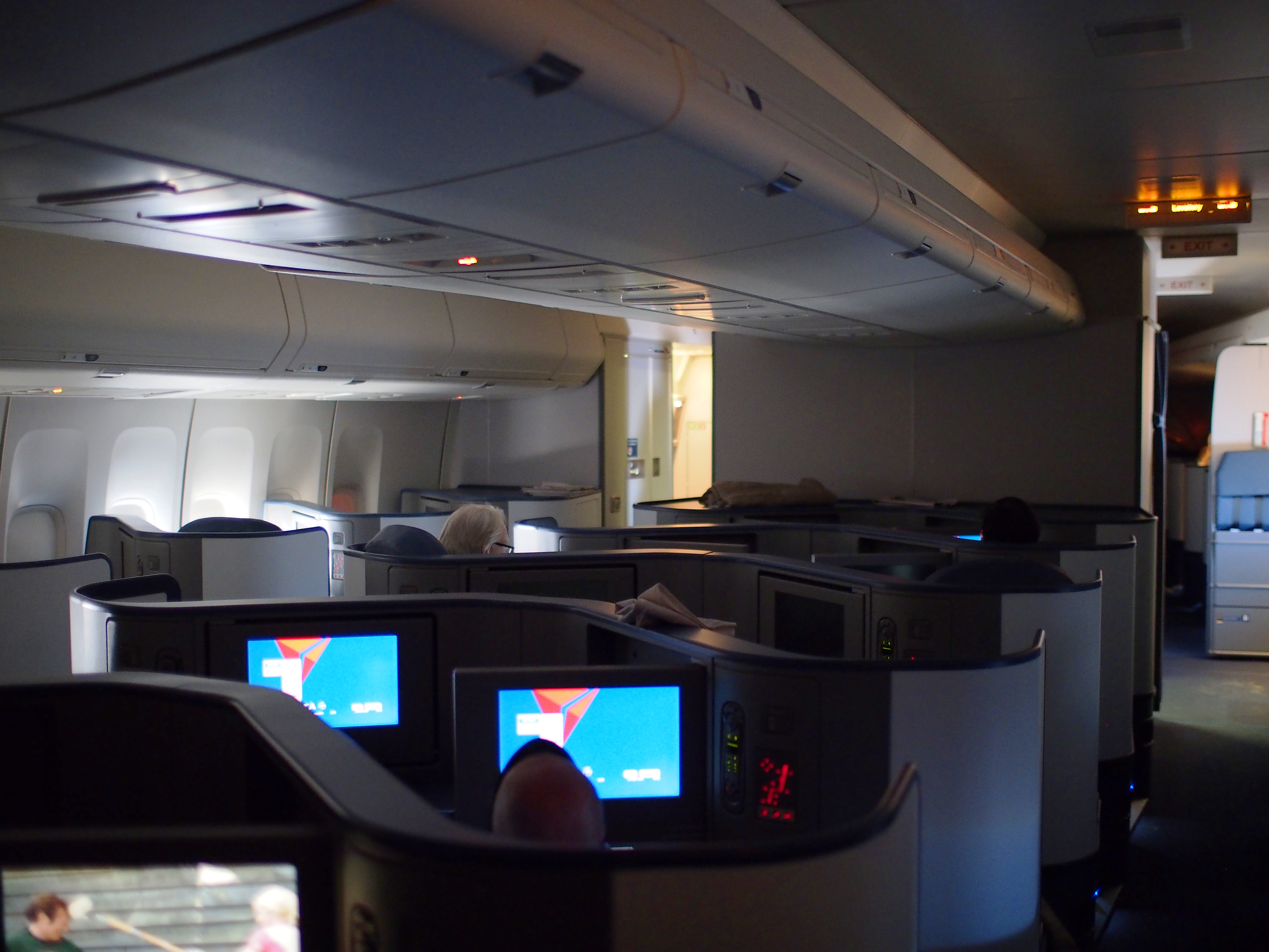 Aircraft cabin with first class seats.
