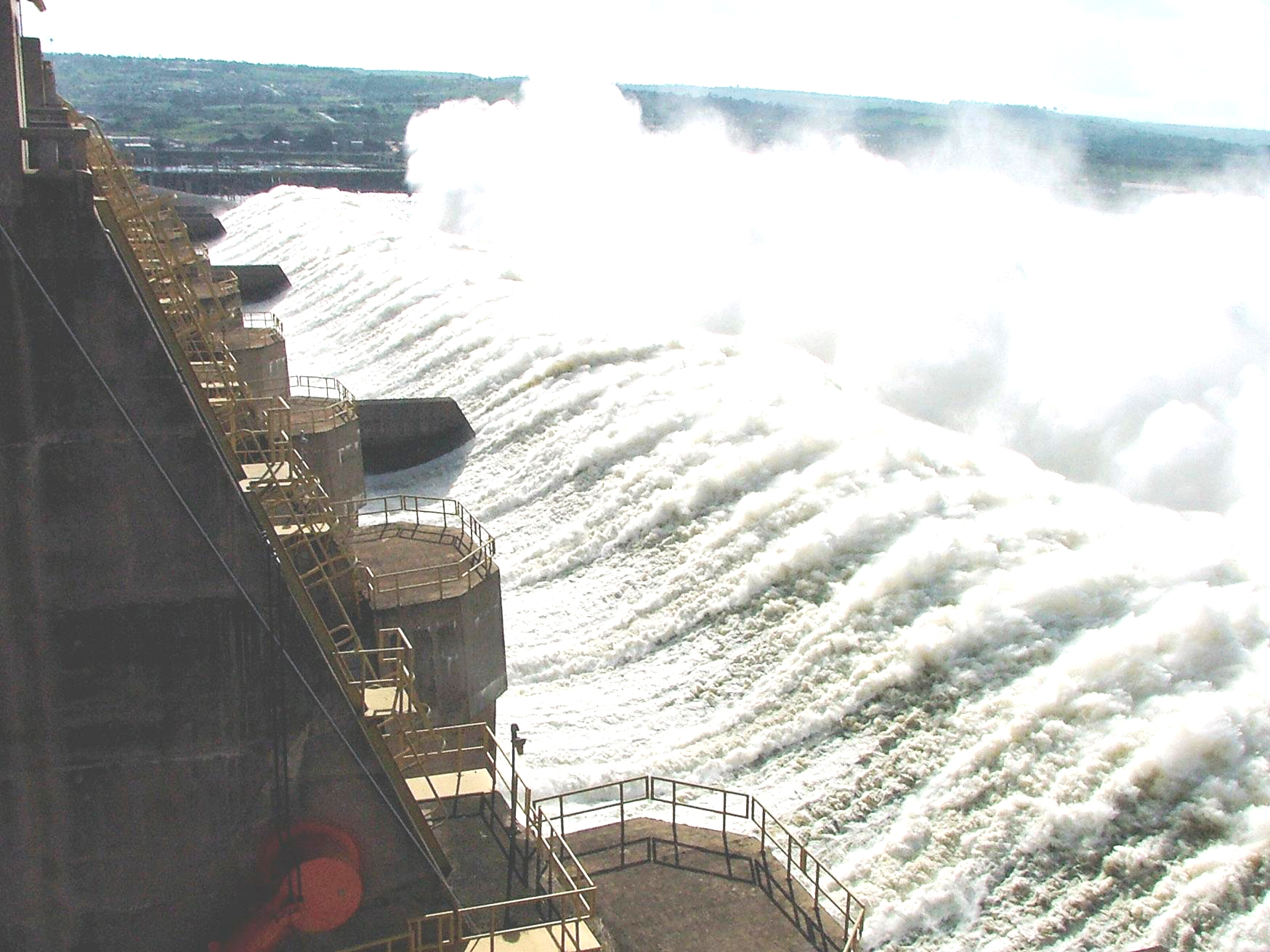 List of major power stations in yunnan - Aerial View Of A Concrete Structure A Low Hill And Massive Amounts Of Water That