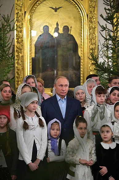 Vladimir Putin celebrates Christmas with orthodox Christians in St Petersburg (2019-01-07) 9.jpg