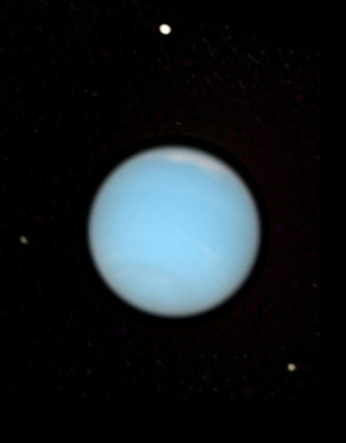 Natural-colour view of Neptune with Proteus (top), Larissa (lower right), and Despina (left), from the Hubble Space Telescope Neptune-visible.jpg