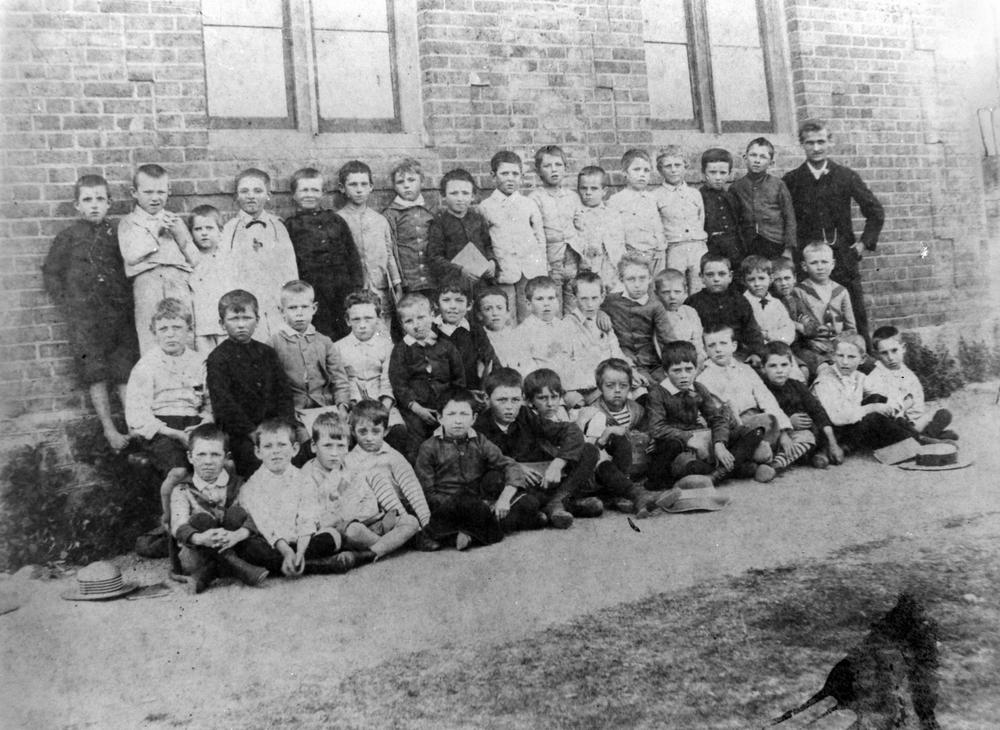 English: Group photograph of teacher and stude...