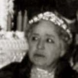 Black-and-white photograph showing the head of a 69-year-old white Circassian woman facing left.