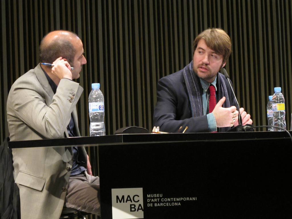 Albert Serra (right) at a conference <br>at the [[MACBA]] in 2012