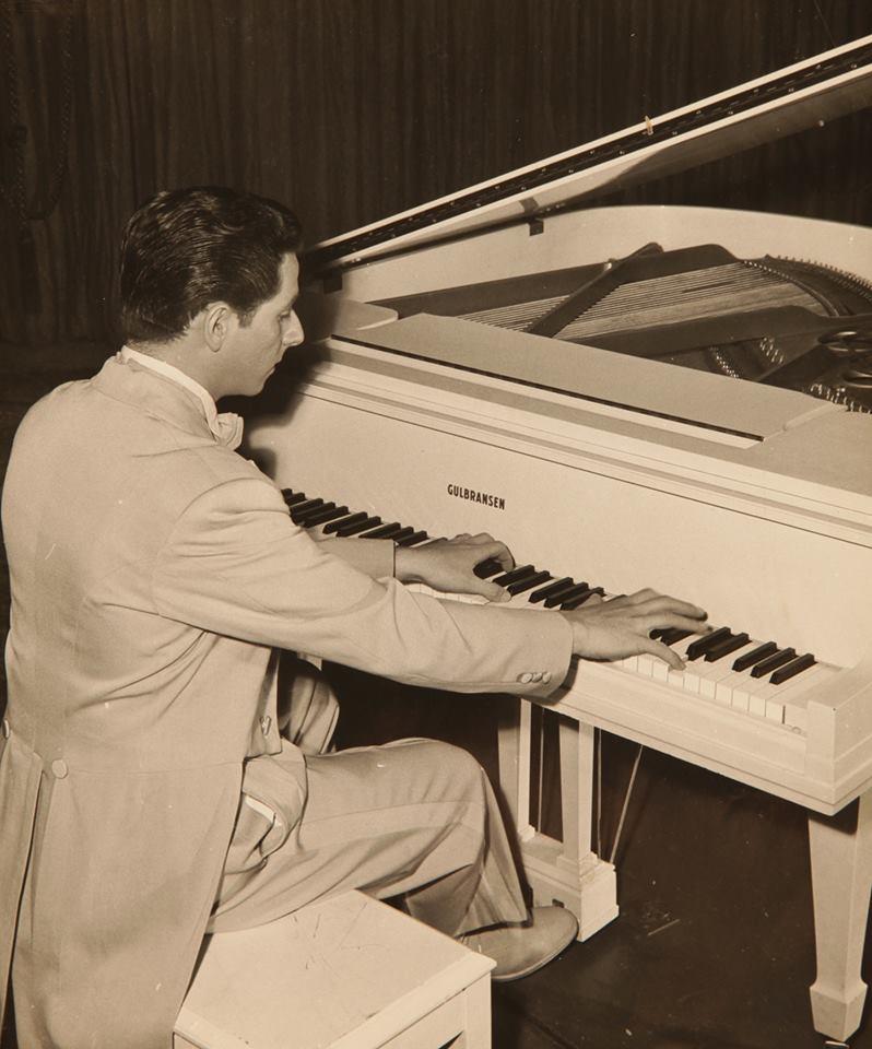 ARtie Kane playing piano