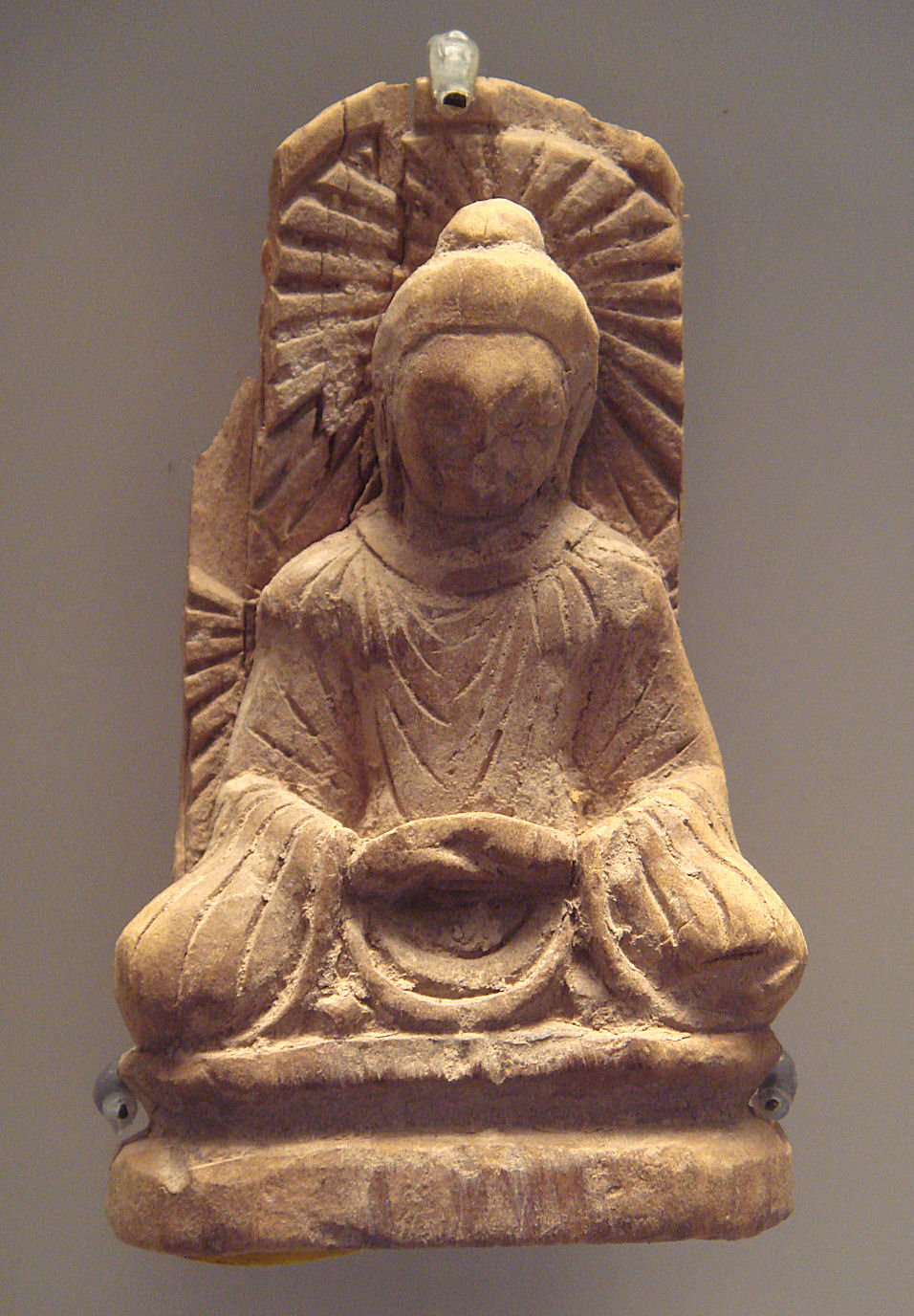 A Buddha statue from Tumshuq, Xinjiang (5th century CE). This is an example of Serindian art.