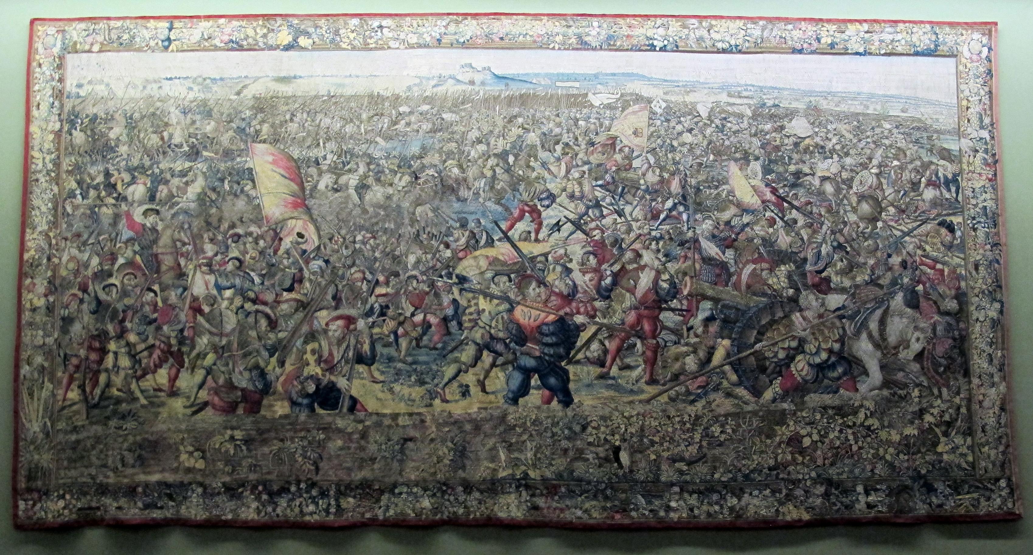 https://upload.wikimedia.org/wikipedia/commons/6/64/Manif._di_bruxelles_su_dis.di_bernart_von_orley%2C_arazzi_della_battaglia_di_pavia%2C_sconfitta_della_cavalleria_francese%2C_IGMN144484%2C_1526-31.JPG