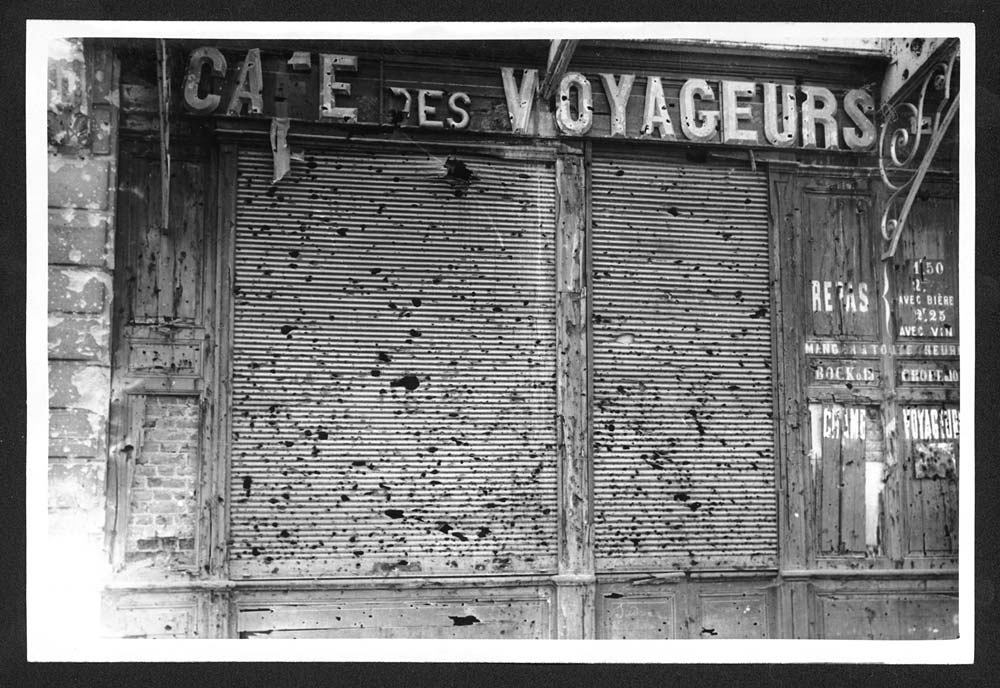 File:Shutter of a shop in the Station Sq., Arras, shrapnel has done this (4699419874).jpg
