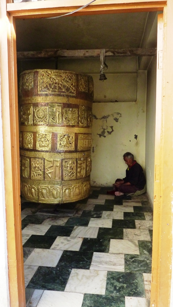 The prayer wheel in the temple courtyard. Photo credit: John Hill/Wikimedia Commons [CC  Creative Commons Attribution-Share Alike 3.0 Unported].
