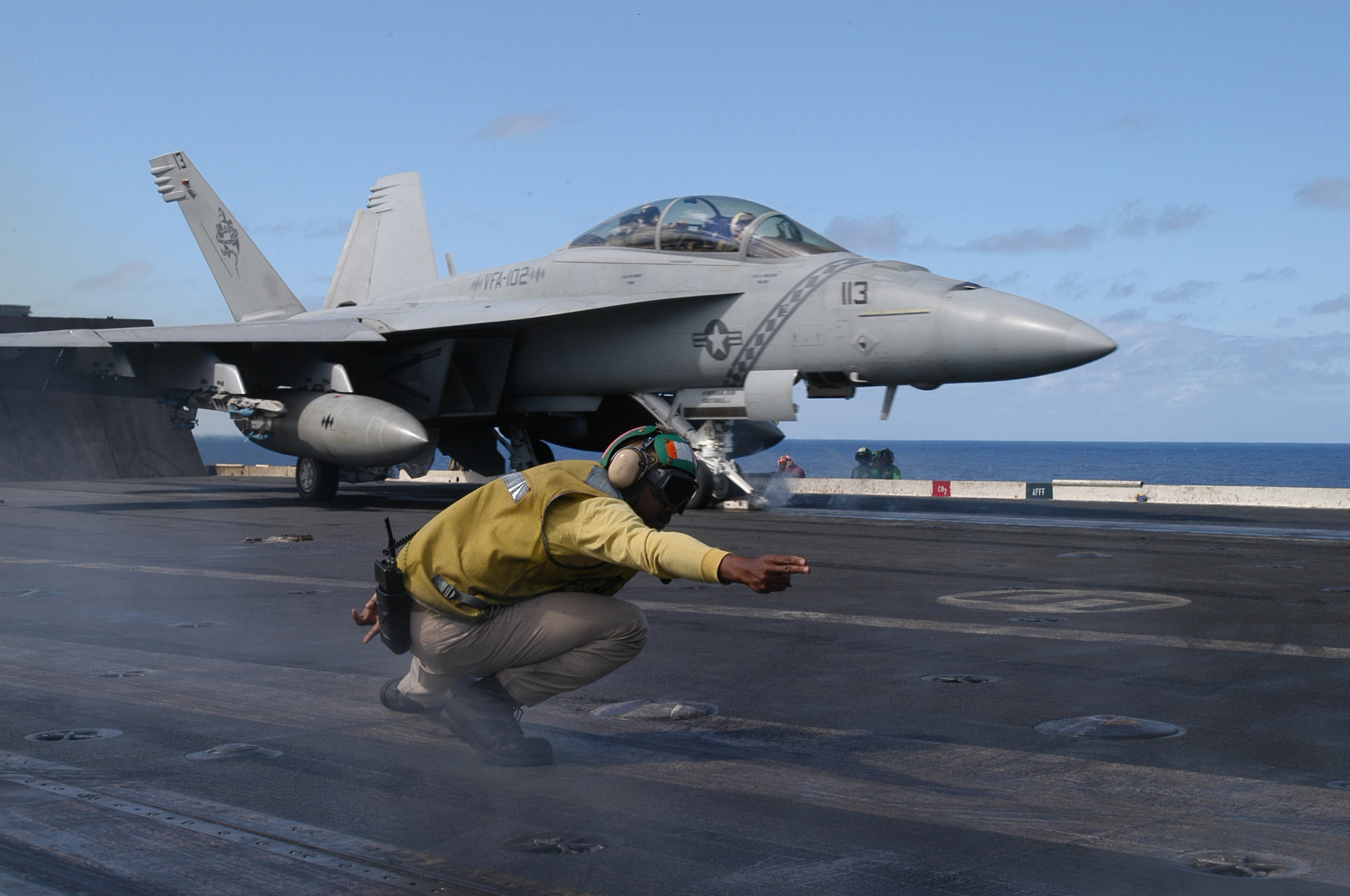 File:US Navy 040420-N-5781F-007 A Catapult officer signals the launch of an F-A-18F Super Hornet.jpg