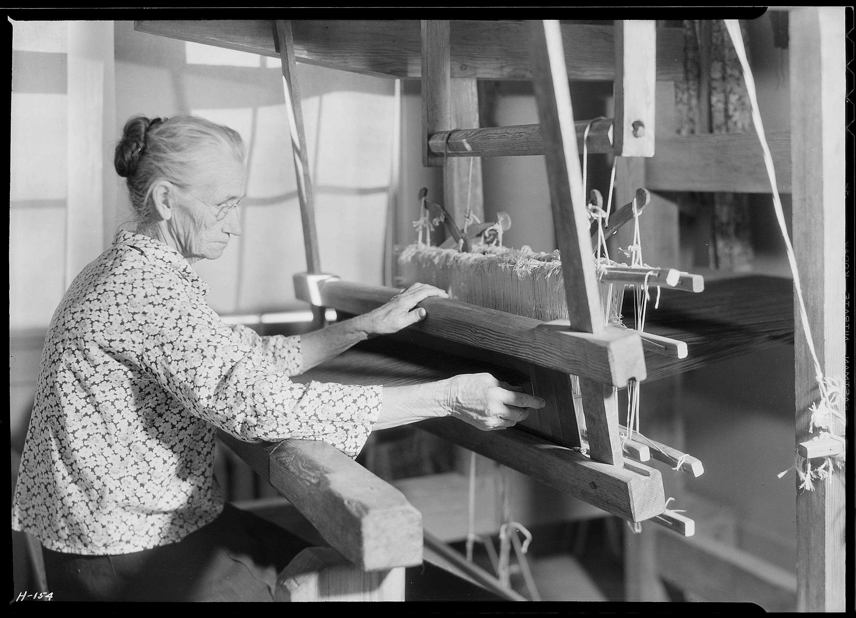 Another view of Aunt Lizzie Reagan weaving old-fashioned jean at the ...