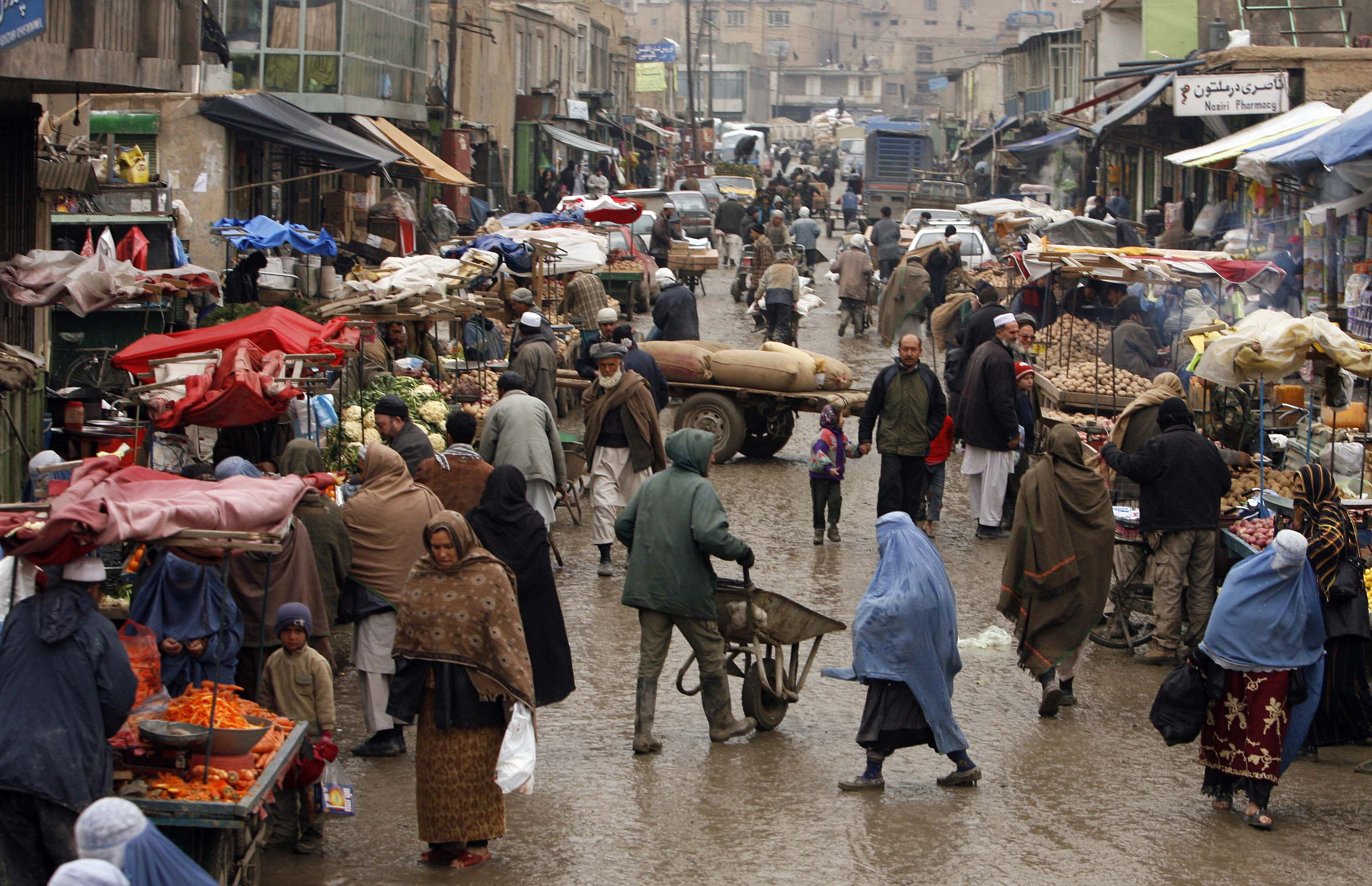 A busy, busy rainy day bustling with people in a crowded street market