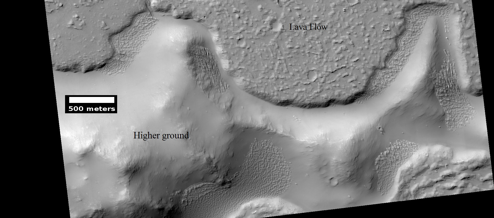 Lava flow. Lava flow stopped when it encountered the higher ground of a mound. Picture was taken with HiRISE under HiWish program.