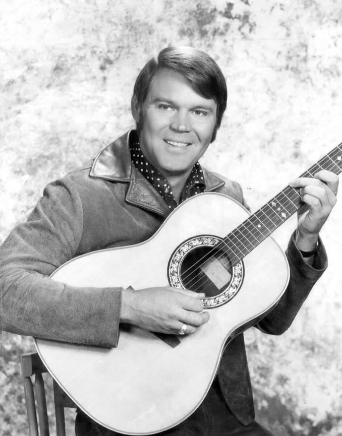 Glen Campbell with his guitar