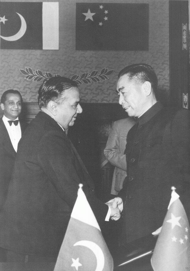 Huseyn Shaheed Suhrawardy and Zhou Enlai signing the Treaty of Friendship Between China and Pakistan in Beijing.jpg