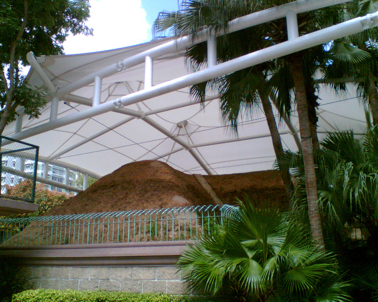Outside view of an ancient tomb museum with protective canopy.