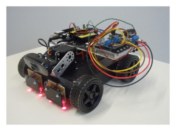 Mobile-robotic-car-MRC.jpg English: Mobile robotic car (MRC). On top of the MRC: the BeagleBone Board Rev A6, the Atmega168-based motor drive
