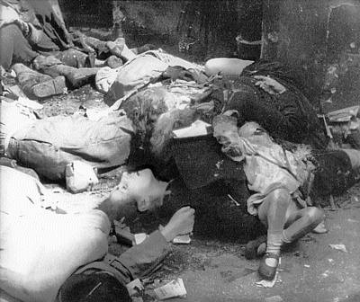 Polish civilians murdered by German SS troops, during the Warsaw Uprising, August 1944 Polish civilians murdered by German-SS-troops in Warsaw Uprising Warsaw August 1944.jpg