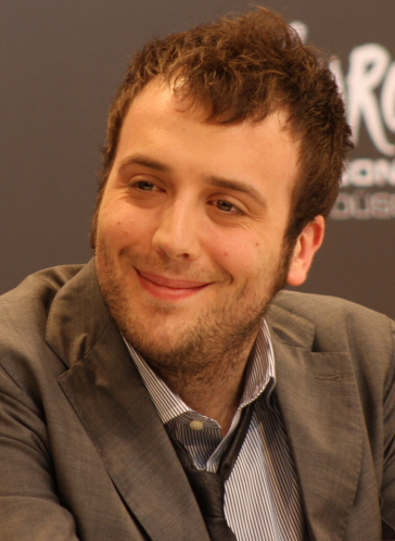 "Raphael Gualazzi won the Critics Award in the Newcomers section in 2011, with the song ""Follia d'amore"". Raphael Gualazzi cropped.jpg"