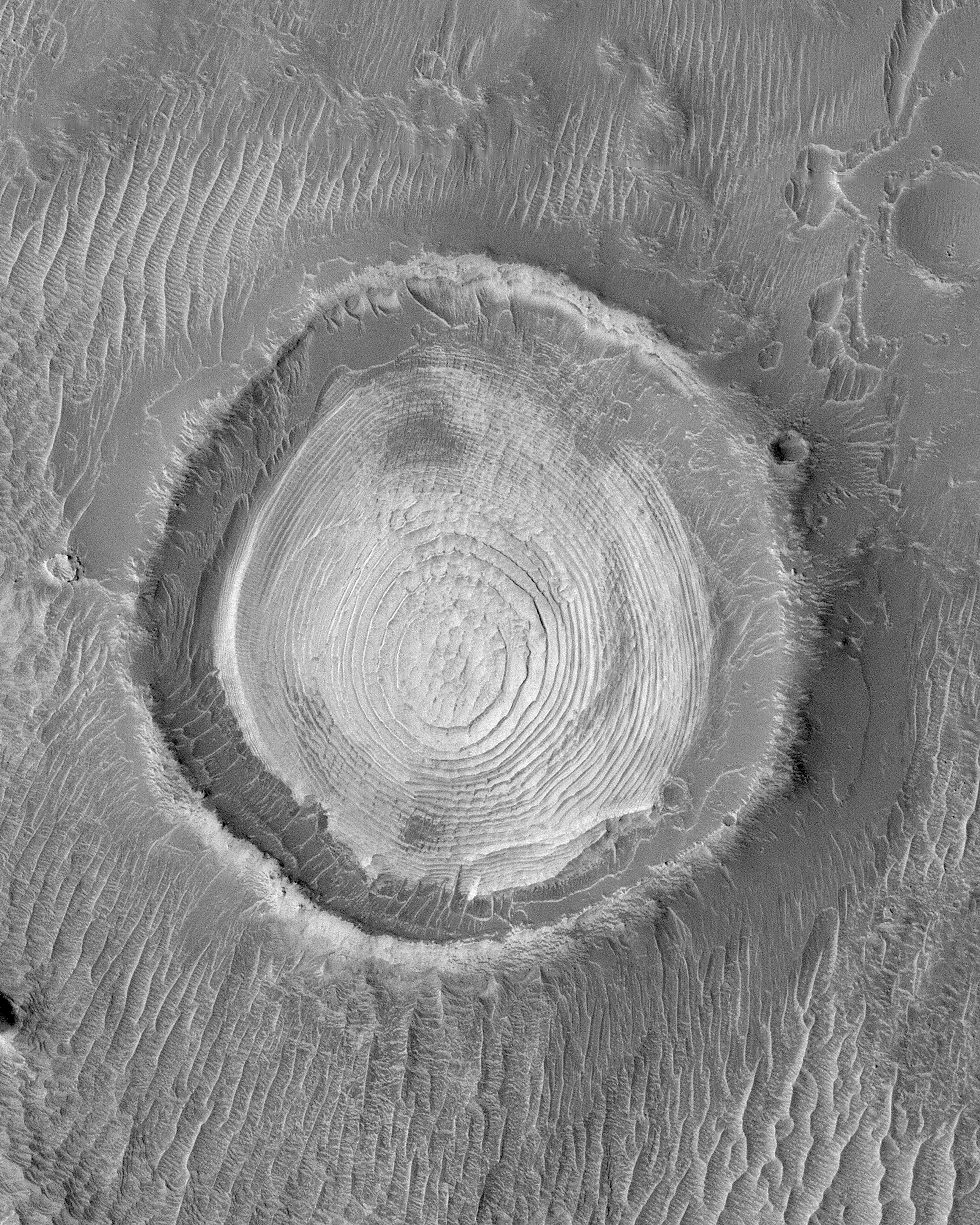 Layers in crater found within the Schiaparelli Crater basin as seen by Mars Global Surveyor