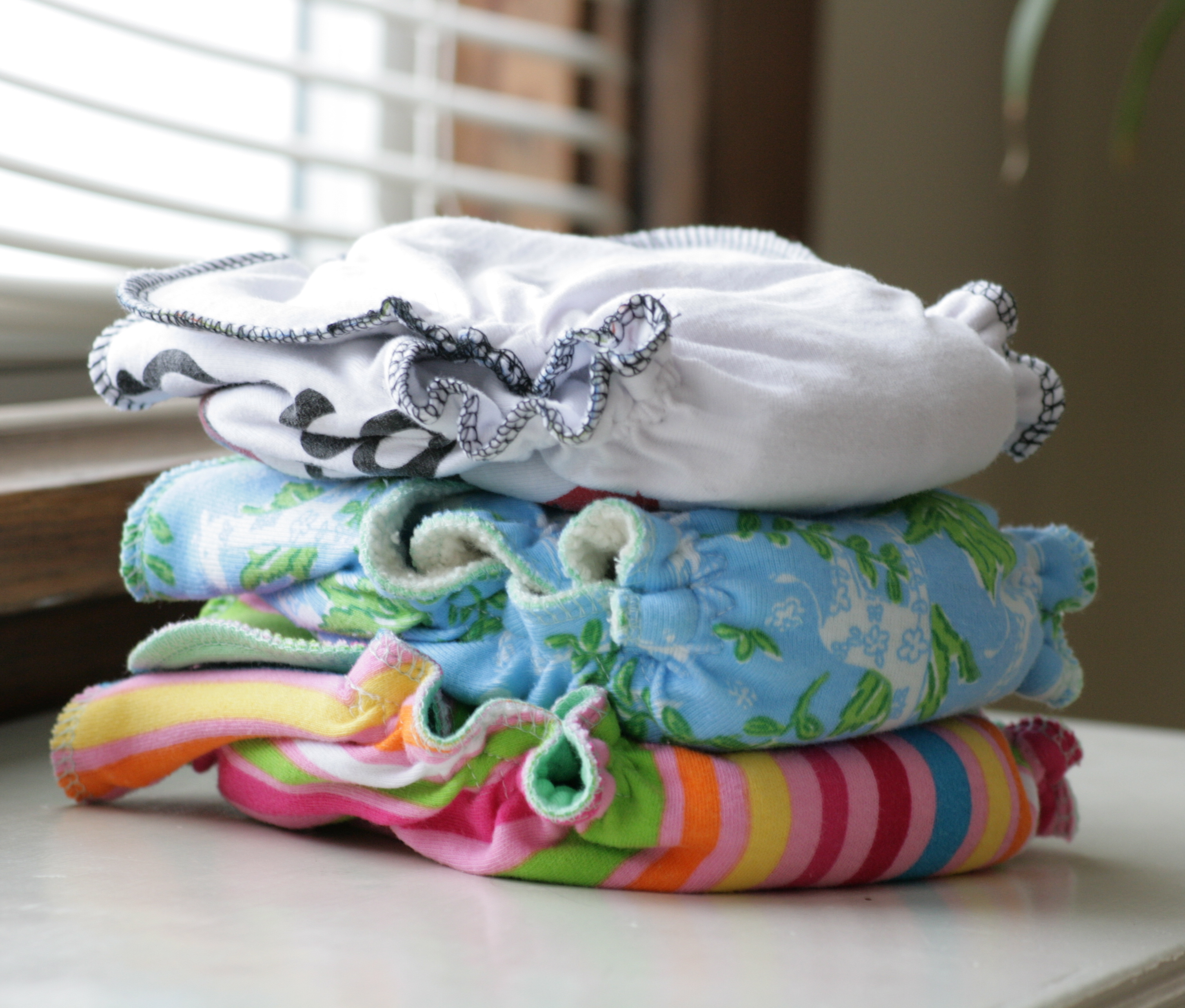 cloth diaper reviews stack of cloth diapers image
