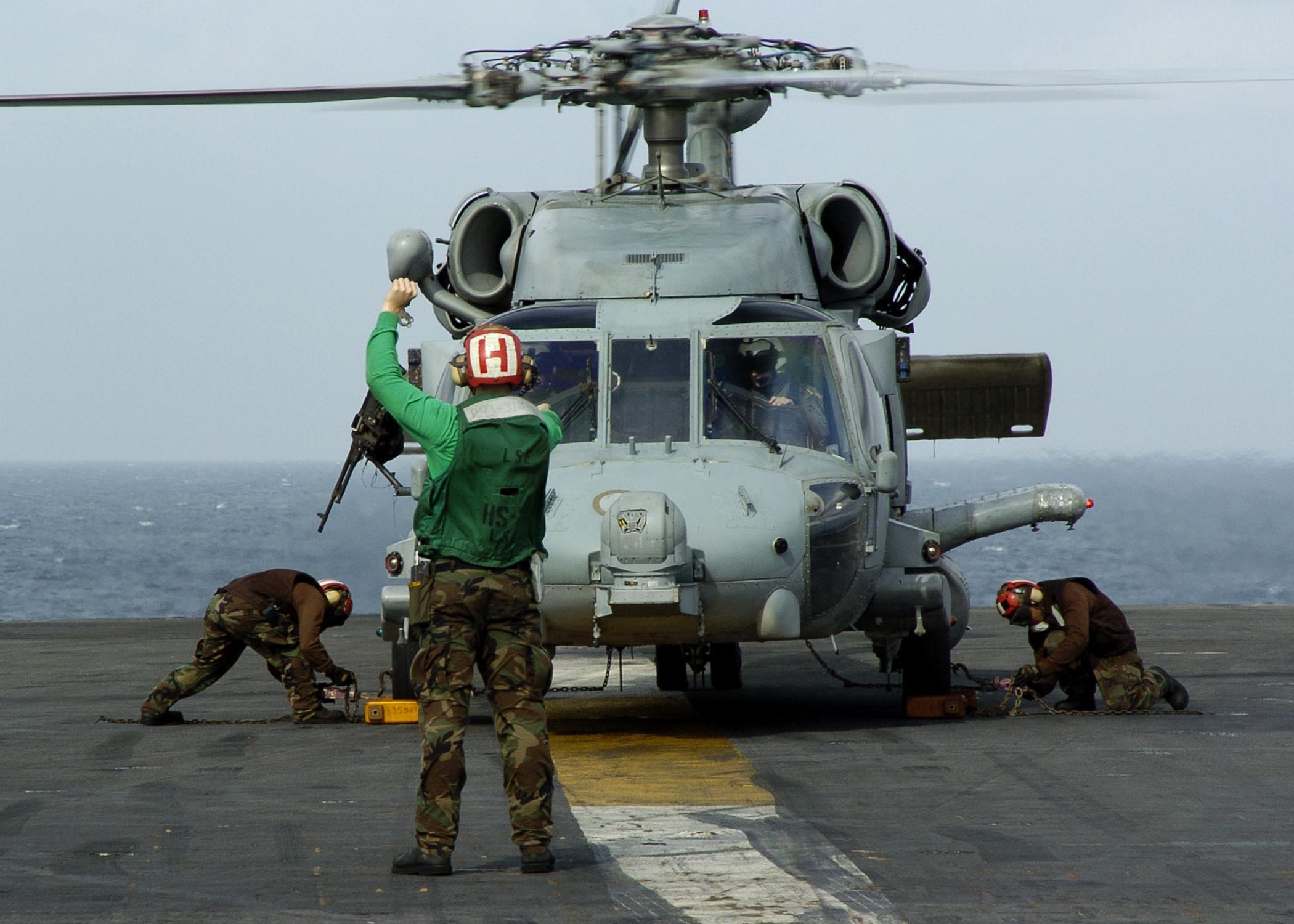 us navy helicopter with File Us Navy 050101 N 6817c 059 An Sh 60 Seahawk Helicopter Assigned To Helicopter Anti Submarine Squadron Two  Hs 2  Golden Falcons Is Prepared To Depart Uss Abraham Lincoln  Cvn 72  En Route To Aceh  Sumatra  Indonesia on File US Navy 050709 N 0050T 018 U S  Navy Chaplain  Cmdr  Ab Bihn Nguyen delivers an invocation during a funeral service held in honor of Senior Chief  SEAL  Daniel R  Healy  at St  Charles Borromeo Catholic Church furthermore H 56 walk besides File us navy 020223 N 6492h 501 uss john f  kennedy passes gibraltar moreover File PBY Catalina michael furthermore File US Navy 051025 M 6538A 013 A U S  Marine Corps CH 53 Super Stallion helicopter  assigned to Marine Heavy Helicopter Squadron Four Six Six  HMH 466   externally lifts a UH 1N Huey over Iraq.