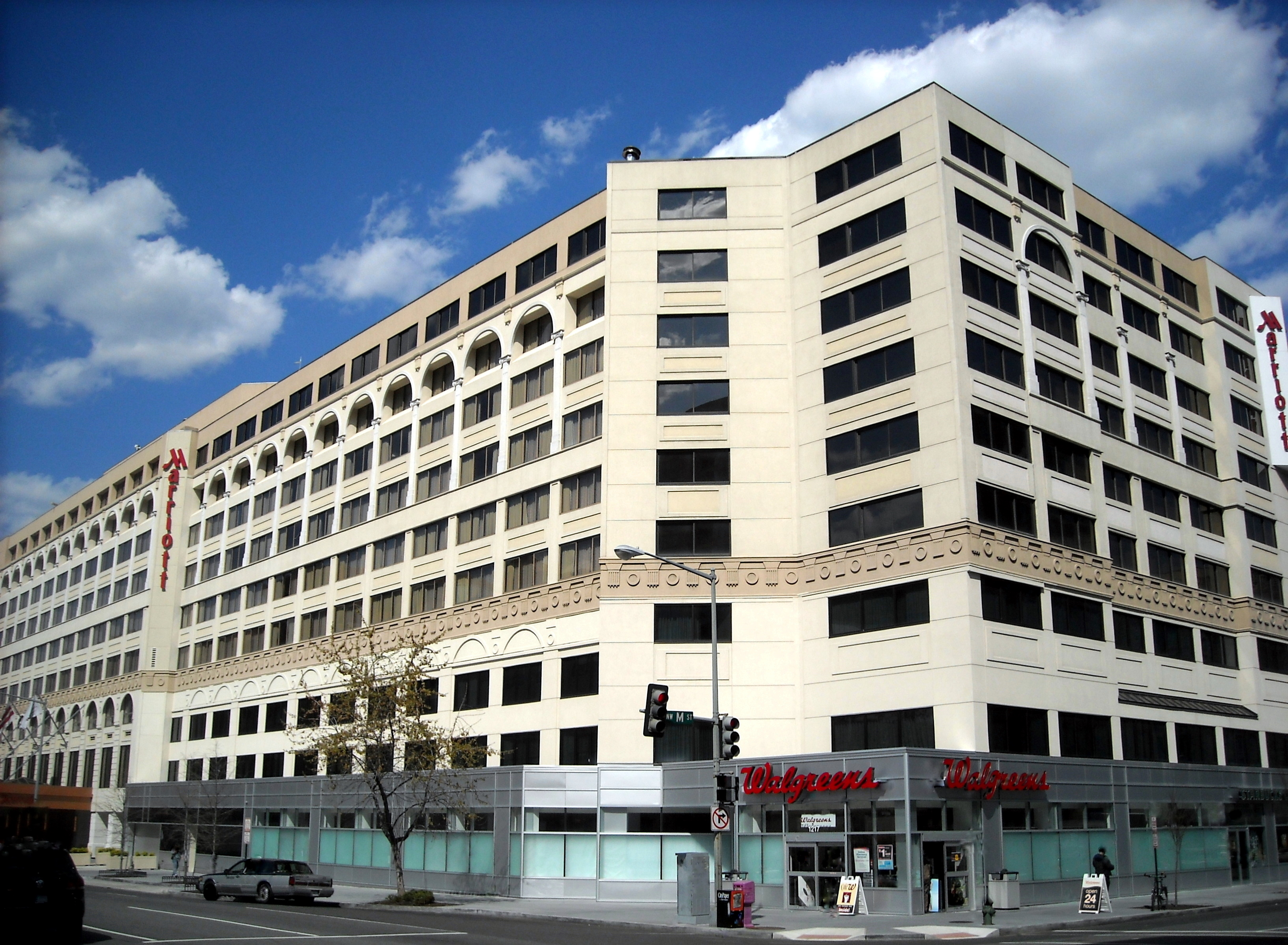 """A Walgreens """"corner drugstore"""", located in a Marriott street-level retail space, on the corner of a heavily trafficked intersection in Washington, D.C"""
