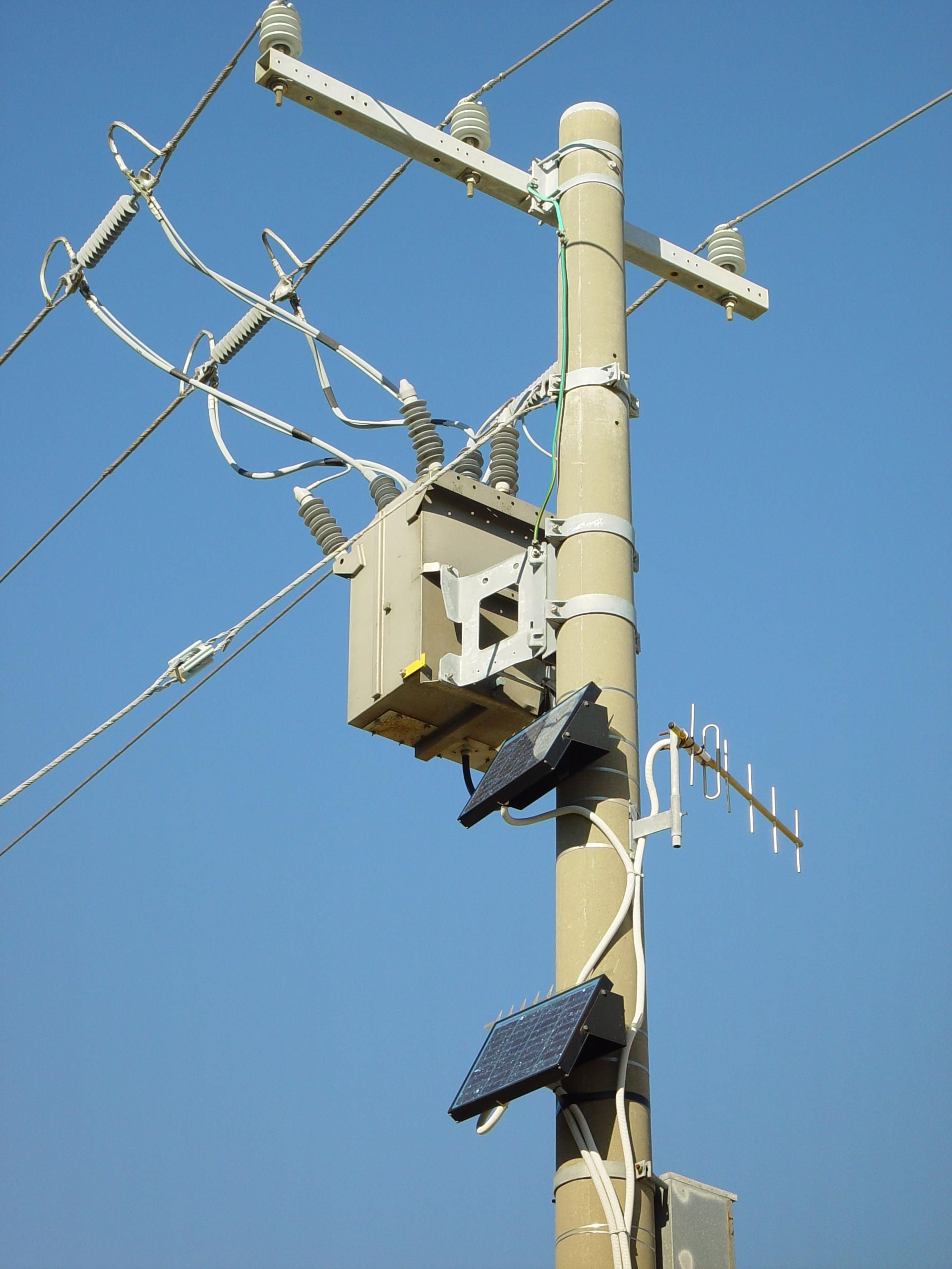 File:Busy power pole with solar panels.jpg - Wikimedia Commons