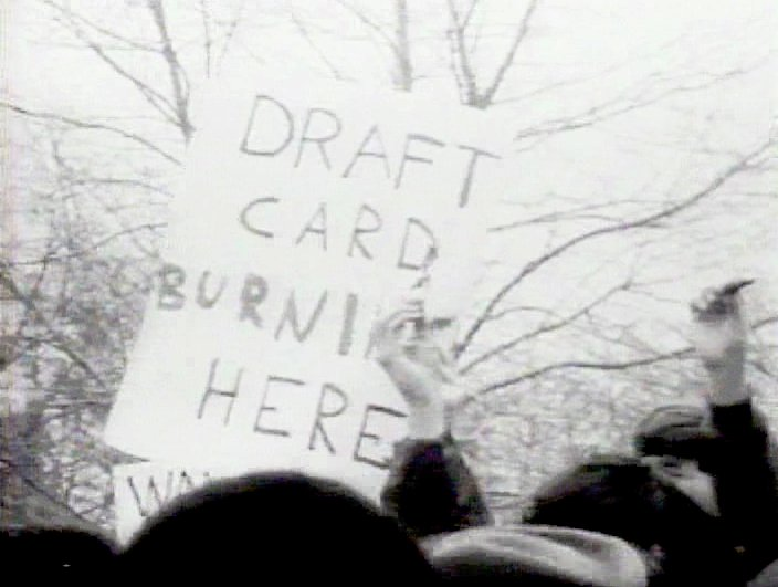 Draft Card burning on four square symbol
