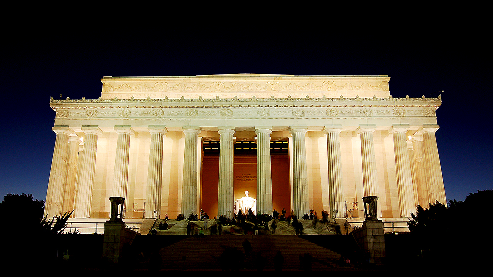 Lincoln Memorial is a square off white greek style building with large pillars on the front
