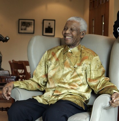 "Mandela on a visit to Australia in 2009; he is wearing one of the brightly coloured garments that became known as ""Madiba shirts"" Nelson Mandela (cropped).jpg"
