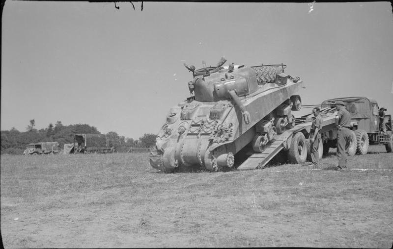 A disabled Sherman unloaded from a Scammell transporter