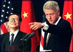 Bill Clinton and Jiang Zemin holding a joint p...