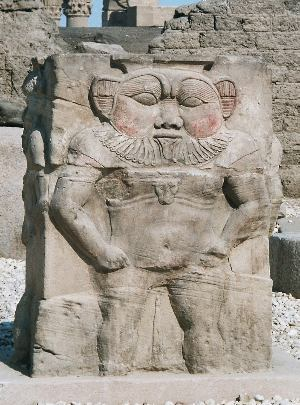 Relief carving of the Egyptian god Bes, from Dendera