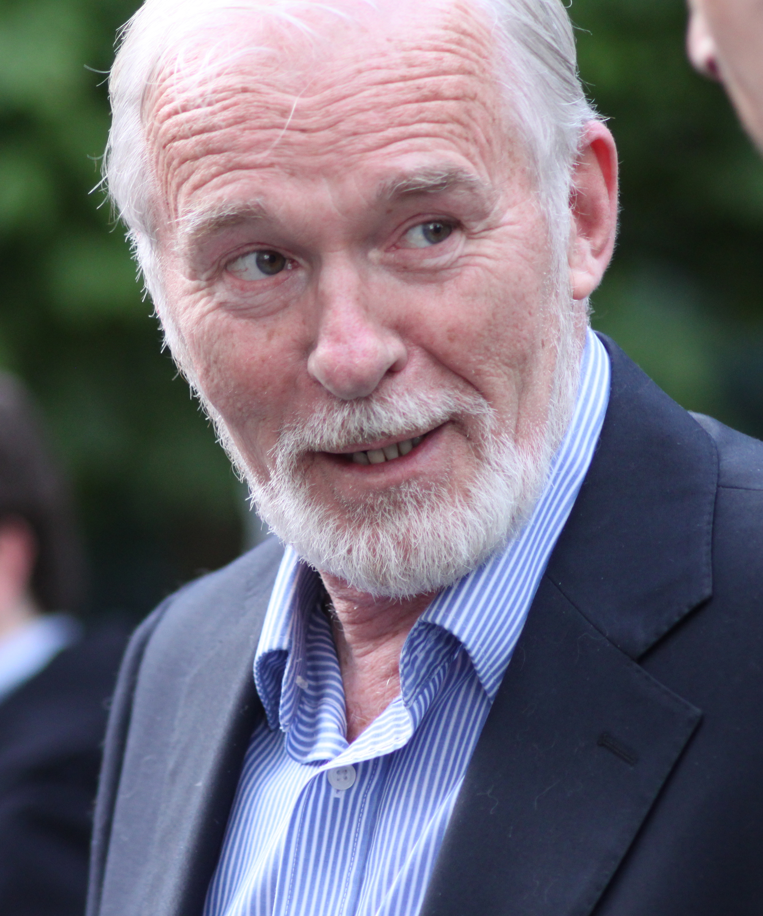 The 70-year old son of father (?) and mother(?) Ian McElhinney in 2018 photo. Ian McElhinney earned a  million dollar salary - leaving the net worth at 2 million in 2018