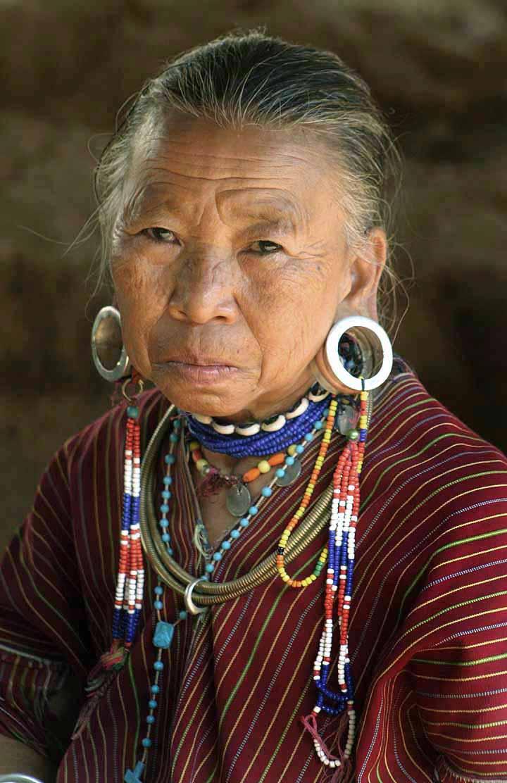 Description Tribes woman with ear piercing.jpg