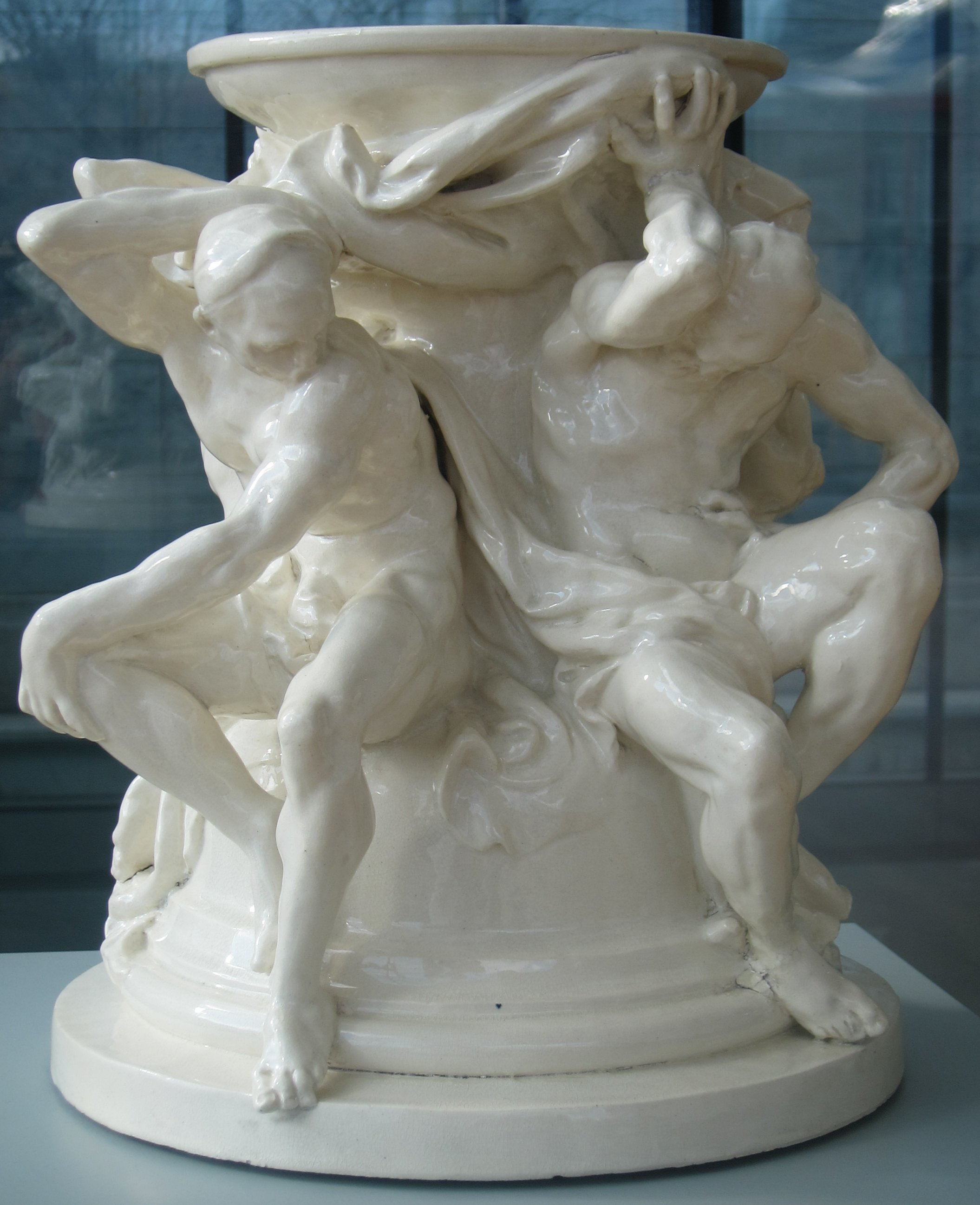 https://upload.wikimedia.org/wikipedia/commons/6/69/%27Titans%2C_Support_for_a_Vase%27_by_Albert-Ernest_Carrier-Belleuse_and_Auguste_Rodin.JPG