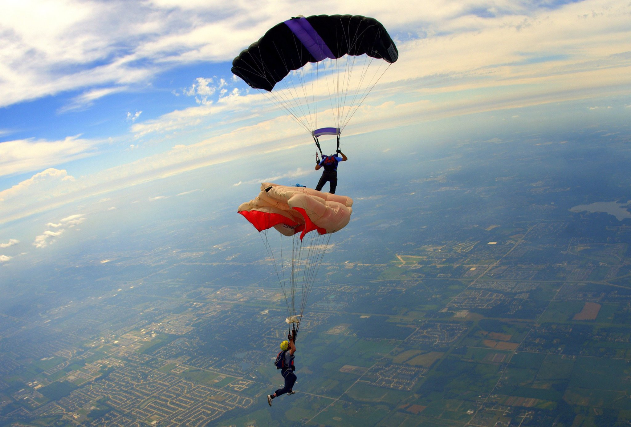 Parachuting wikipedia two parachutists perform a dock on a canopy relative work crew jump ccuart Choice Image