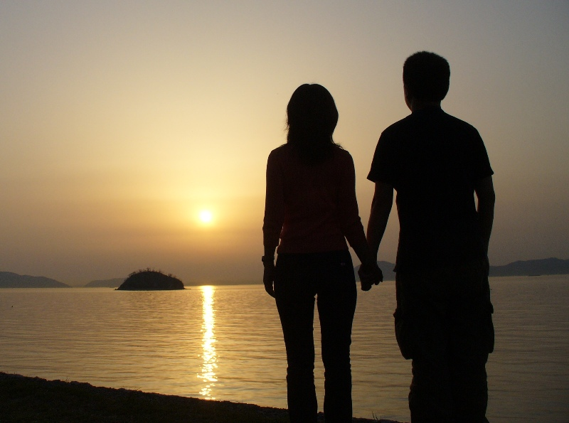 Couple together watching sunset