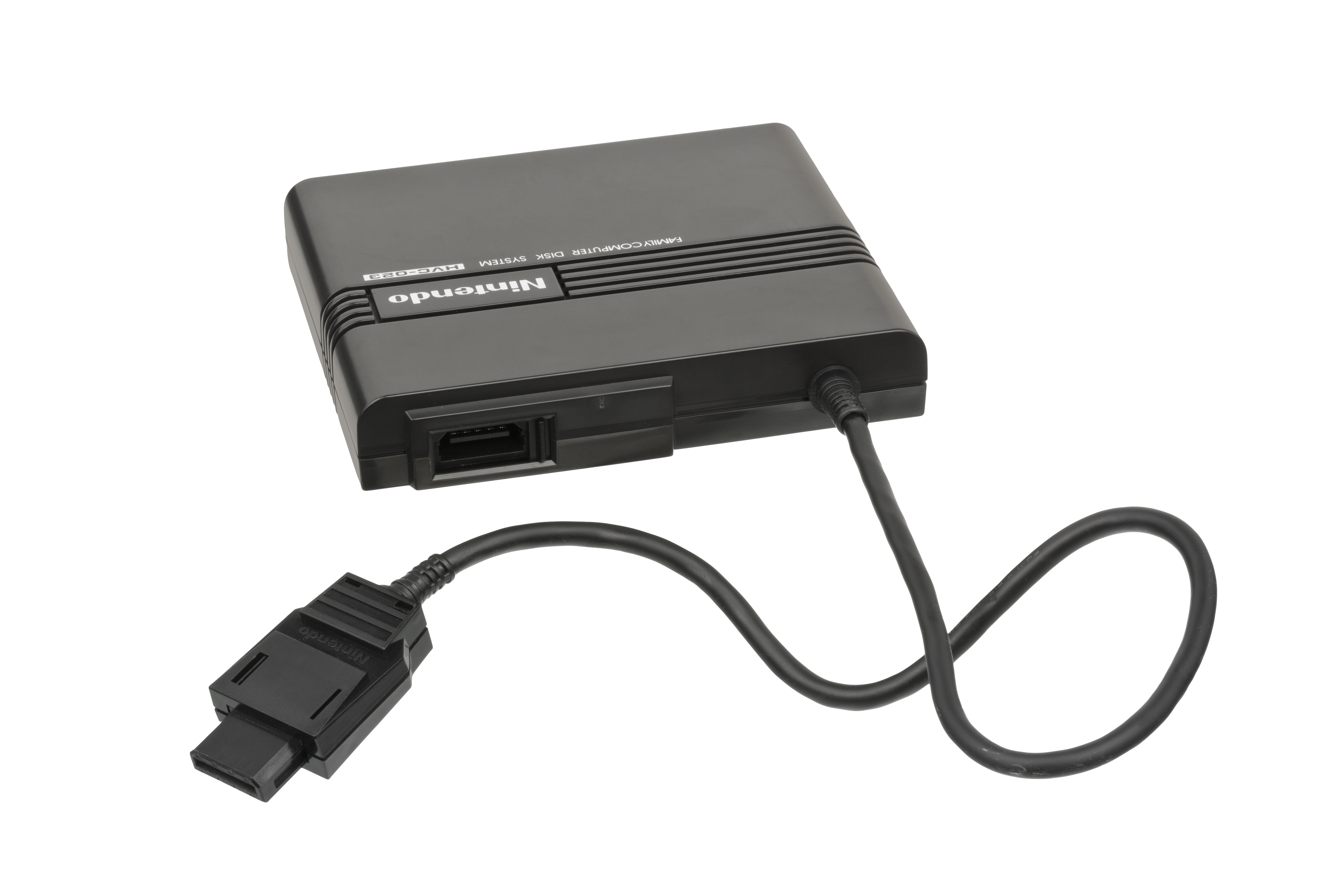 add-on for the Japanese Nintendo Famicom video game console. This was inserted into the cartridge slot of the Famicom and plugged into the disk drive