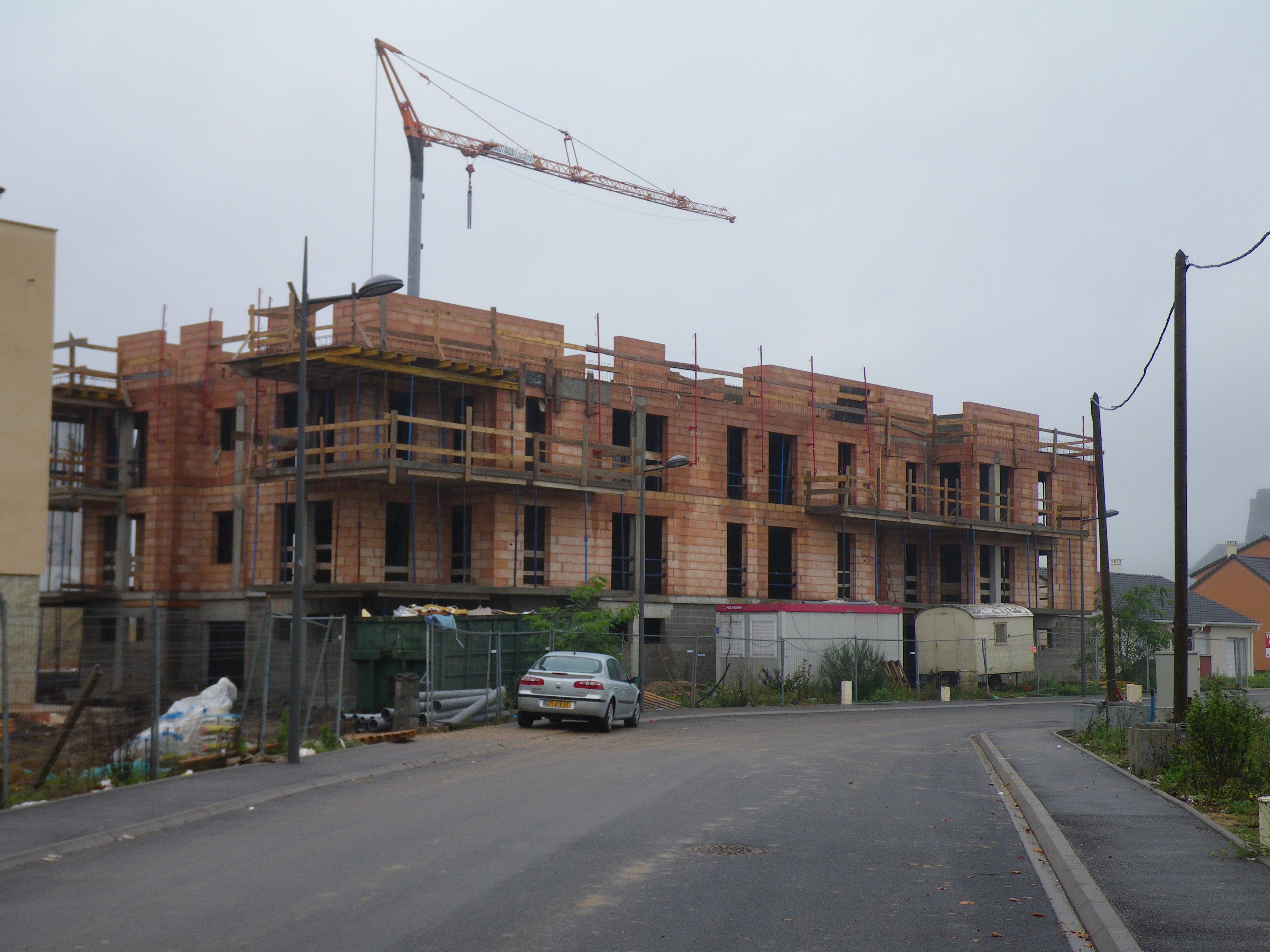 File amn ville buildings under construction for Building under construction insurance