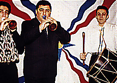 Assyrians playing zurna and Davul, the typically used instruments for their folk music and dance. Assyrianfolk.jpg